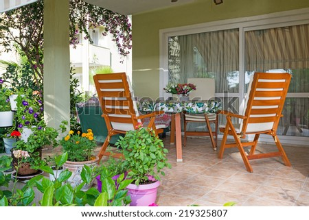 Patio and garden of family home  - stock photo