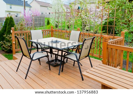 Patio and garden of family home in early spring at evening. - stock photo