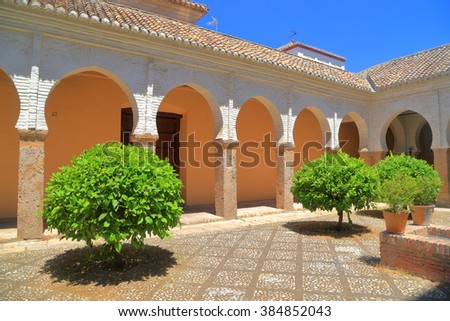 Patio of San Salvador church with small green trees, Granada, Andalusia, Spain - stock photo