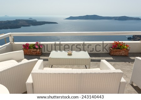 Patio with caldera view in traditional Santorini house - stock photo