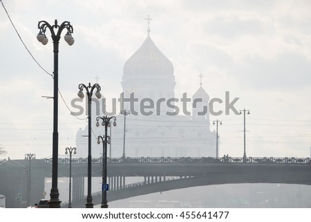 Patriarchal bridge, lanterns, Christ Savior Cathedral in fog in Moscow, Russia - stock photo