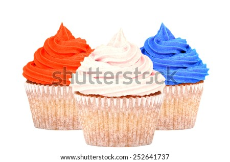 Patriotic cupcakes topped with red, white and blue frosting, isolated on a white background - stock photo