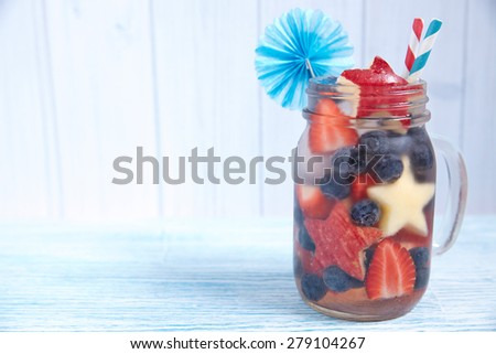 Patriotic drink cocktail with strawberry, blueberry and apple - stock photo