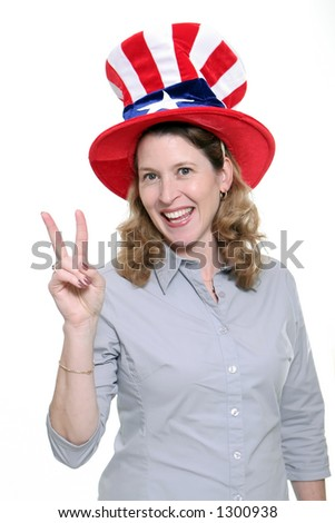 Patriotic woman showing the peace symbol isolated against a white background. - stock photo