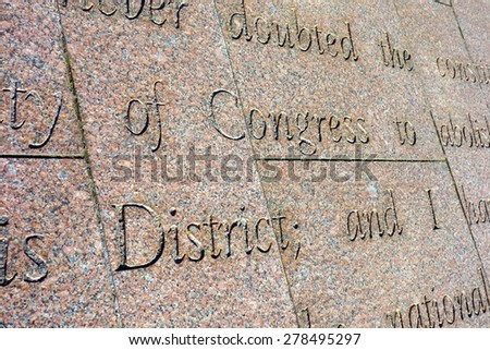 Patriotic words engraved in the stone in Washington DC - stock photo