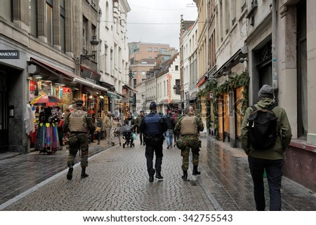 Patrol on Rue de l'Etuve in center of Brussels, Belgium on 20 November, 2015. Soldiers and police patrol streets together. - stock photo