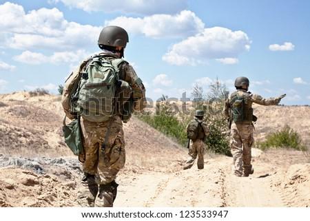 patrolling across the desert - stock photo