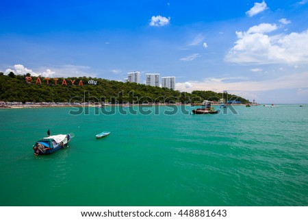 Pattaya beach and boat behind mountain background - stock photo