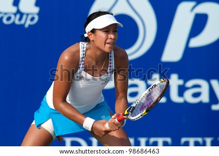 PATTAYA THAILAND - FEBRUARY 9: Anne Keothavong of Great Britain prepares to return a serve during Round 2 of PTT Pattaya Open 2012 on February 9, 2012 at Dusit Thani Hotel in Pattaya, Thailand - stock photo