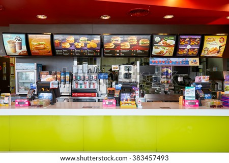 PATTAYA, THAILAND - FEBRUARY 25, 2016: inside of McDonald's restaurant. McDonald's primarily sells hamburgers, cheeseburgers, chicken, french fries, breakfast items, soft drinks, milkshakes, desserts - stock photo