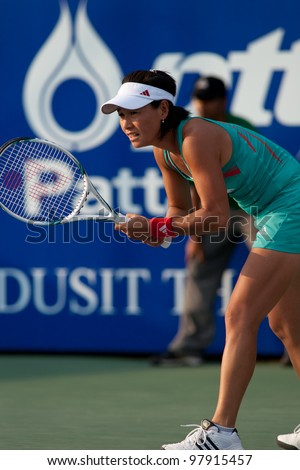 PATTAYA THAILAND - FEBRUARY 9: Kimiko Date-Krumm of Japan prepares to return a serve during Round 2 of PTT Pattaya Open 2012 on February 9, 2012 at Dusit Thani Hotel in Pattaya, Thailand - stock photo