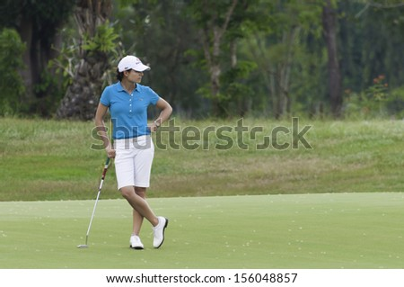 PATTAYA THAILAND-FEBRUARY 21-Lorena Ochoa of Mexico stands on green in Final Round of Honda LPGA Thailand 2010 on Feb 21, 2010 at Siam Country Club Old Course in Pattaya, Thailand - stock photo