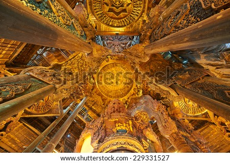 Pattaya, Thailand-February 23, 2014: Sanctuary of Truth is a temple construction in Pattaya. The sanctuary is an all-wood building filled with sculptures based on traditional Buddhist and Hindu motifs - stock photo