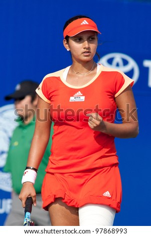 PATTAYA THAILAND - FEBRUARY 9: Sania Mirza of India reacts after winning a point during Round 2 of PTT Pattaya Open 2012 on February 9, 2012 at Dusit Thani Hotel in Pattaya, Thailand - stock photo