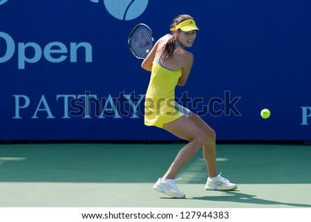 PATTAYA THAILAND - JANUARY 31: Ana Ivanovic of Serbia returns a ball during 1st round of PTT Pattaya Open 2013 on January 31, 2013 at Dusit Thani Hotel in Pattaya, Thailand - stock photo
