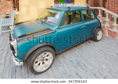 PATTAYA,THAILAND - JANUARY 23,2016 : The classic mini cooper is parked in swiss sheep farm  - stock photo