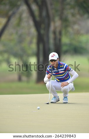 PATTAYA, THAILAND: Na Yeon Choi of South Korea watches lines up a shot during day one of the Honda LPGA Thailand 2015 at Siam Country Club, Pattaya on Feb 26,2015 in Thailand. - stock photo