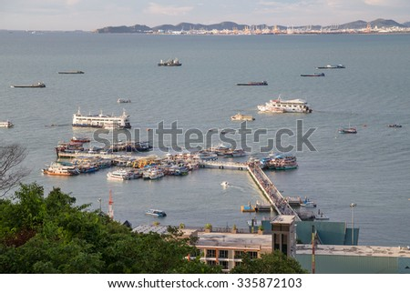Pattaya wharf with panorama of bay and ships - stock photo