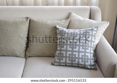 Pattern and texture pillows on beige sofa in the living room - stock photo
