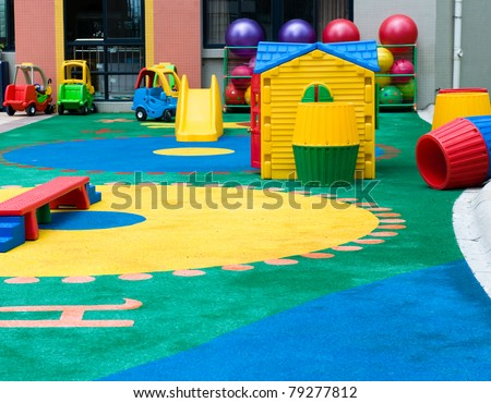 pattern and toy on the playground in a kindergarten. - stock photo