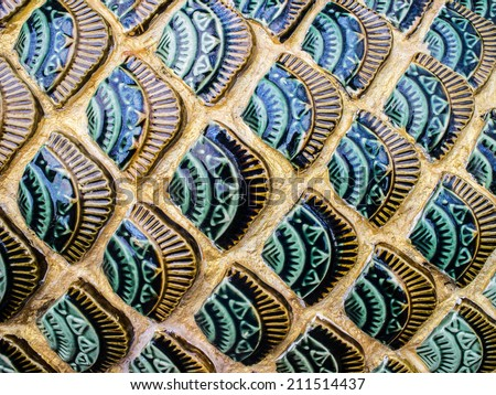 Pattern background in green and gold dragon scales. - stock photo