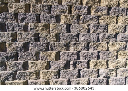 Pattern created by bricks of concrete form a wall. - stock photo