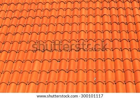 pattern detail of orange ceramic roof tiles - stock photo