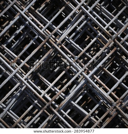 Pattern from stack of rebar grids at the construction site. Top view - stock photo