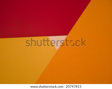 Pattern made with red, orange and yellow cardboard - stock photo