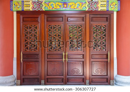 Pattern of chinese monastery wooden door - stock photo
