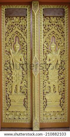Pattern of church door in temple Thailand. - stock photo