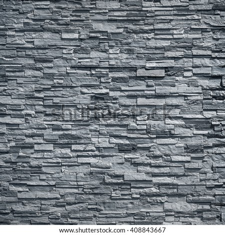 pattern of decorative black slate stone wall surface / black stone - stock photo