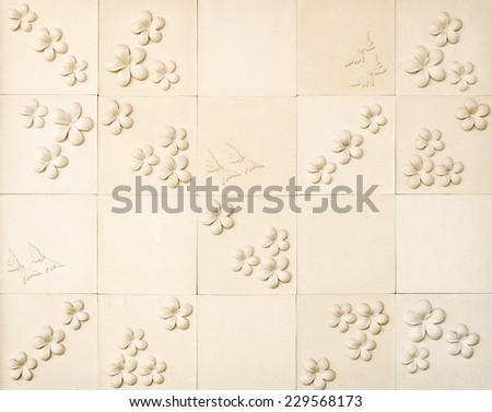 pattern of decorative sand stone wall with flower - stock photo