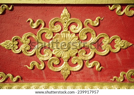 Pattern of flower carved on wall background - stock photo
