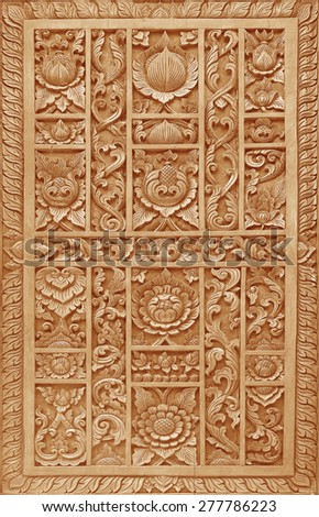 Pattern of flower carved on wood background on the wall of temple Thailand - stock photo