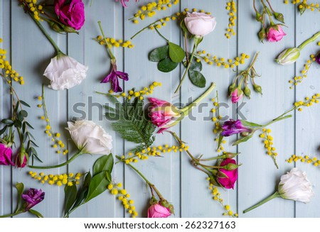 Pattern of Flowers on vintage wood background - stock photo