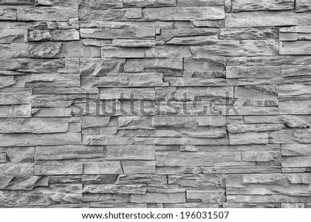 pattern of modern style design cracked real stone wall surface - stock photo