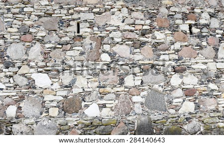 Pattern of modern style design decorative uneven cracked real stone wall  - stock photo