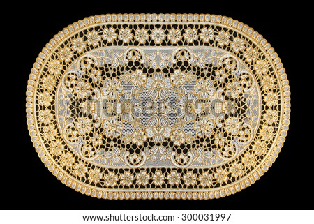 Pattern of Plastic gold floral for tablecloth isolated on black background - stock photo