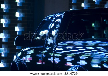 Pattern of reflections of light from wall on driver's side in parking garage - stock photo
