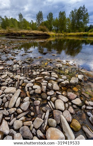 Pattern of rocks in river bed located in Cataldo, Idaho. - stock photo