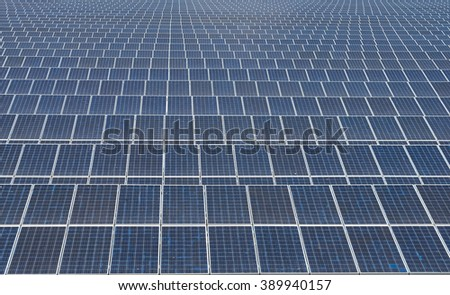 Pattern of solar panels in solar farm power plant - stock photo