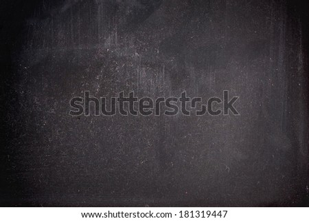 Pattern of the black chalk board background - stock photo