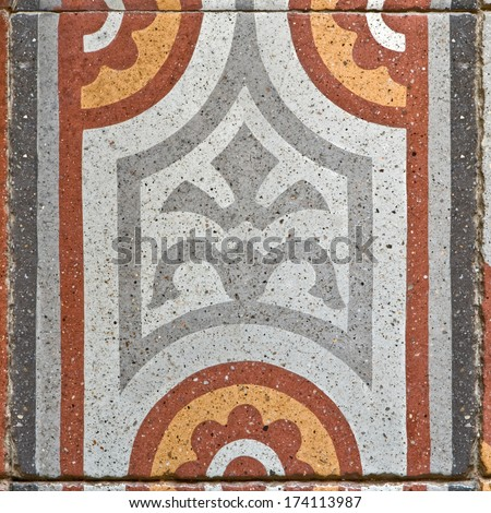 pattern on an ancient square paving tile - stock photo