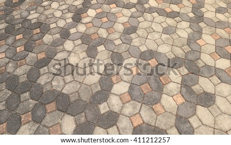 patterned paving tiles, cement brick floor background - stock photo