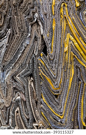 Patterns made of compressed cardboard at the recycling facility - stock photo