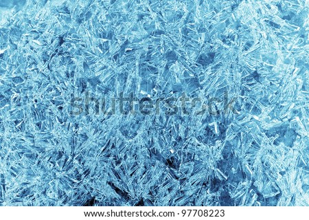 patterns of ice crystals in the background - stock photo