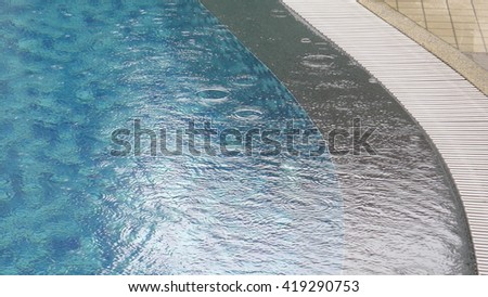 patterns on the surface of pool water in rainy day - stock photo