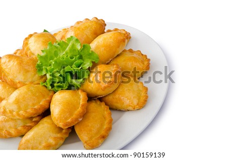 Patties stuffed with meat in the plate - stock photo
