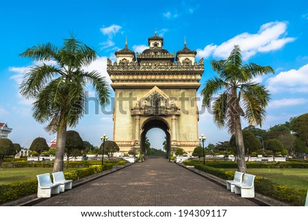 Patuxai (Victory Gate) in Vientiane, Laos A local rendition of Paris' Arc de Triomphe with elaborate Buddhist embellishment. - stock photo